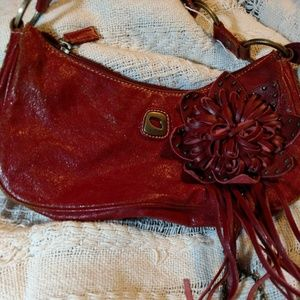 Guess: Distressed red leather and antiqued metal